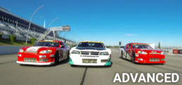 Three stock cars at Pocono Raceway