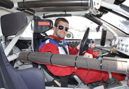 Male driver inside of stock car