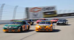 Side shot of stock cars racing at Pocono Raceway