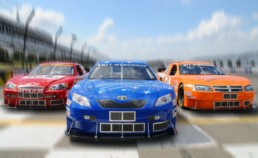 Red, blue, and orange stock cars crossing finish line