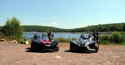 Slingshot parked in front of lake