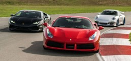 Exotic cars driving on race track